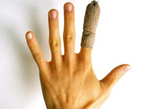 Photo of hand with bandaged finger